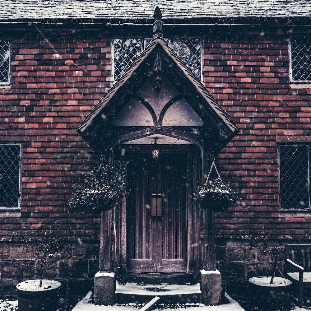 brown wooden door in brown brick building
