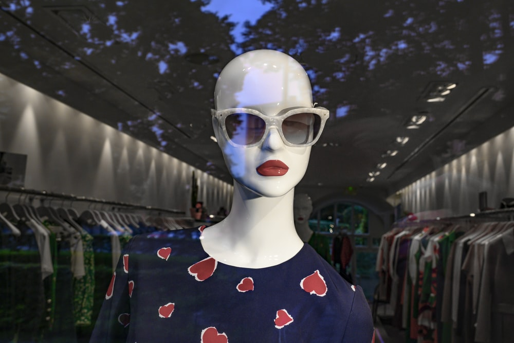person wearing blue and red floral crew neck shirt and white goggles