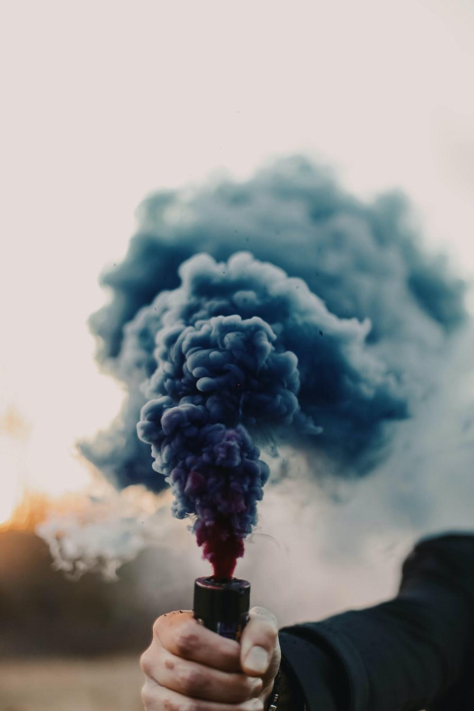 white smoke on black clouds