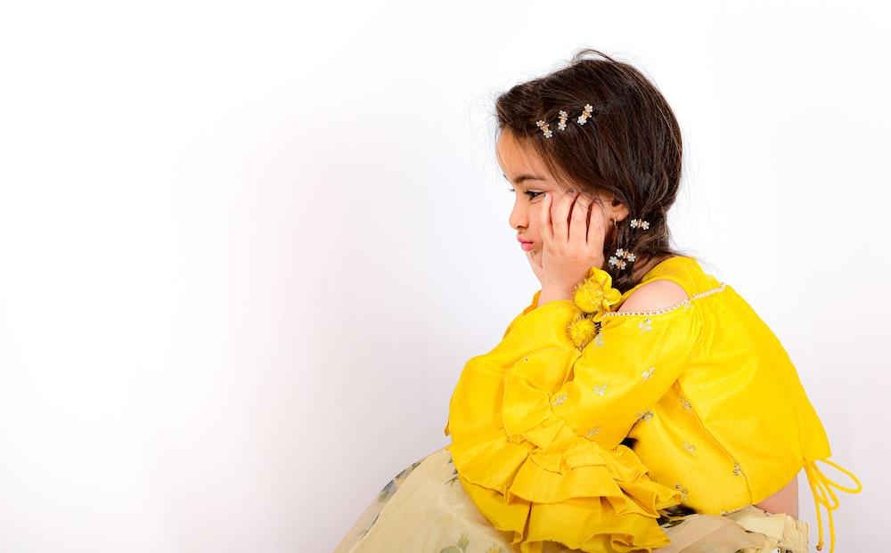 woman in yellow dress shirt