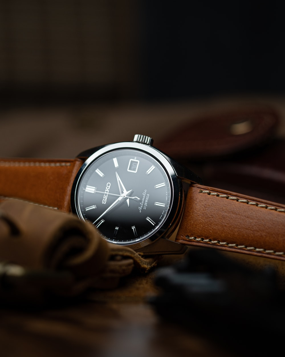 brown leather strap silver round analog watch