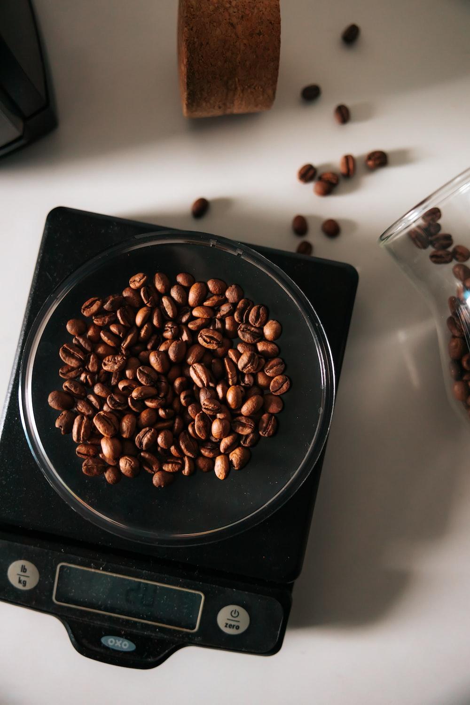 coffee beans on black ceramic bowl