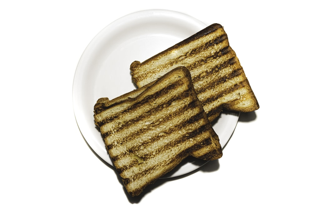 brown and black bread on white ceramic plate