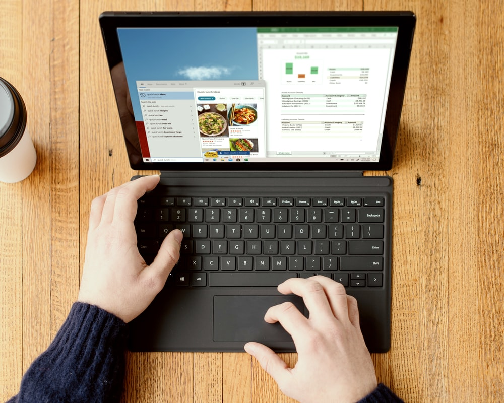 person using black Surface device