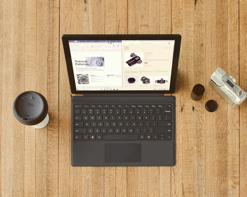 black Surface device on brown wooden table