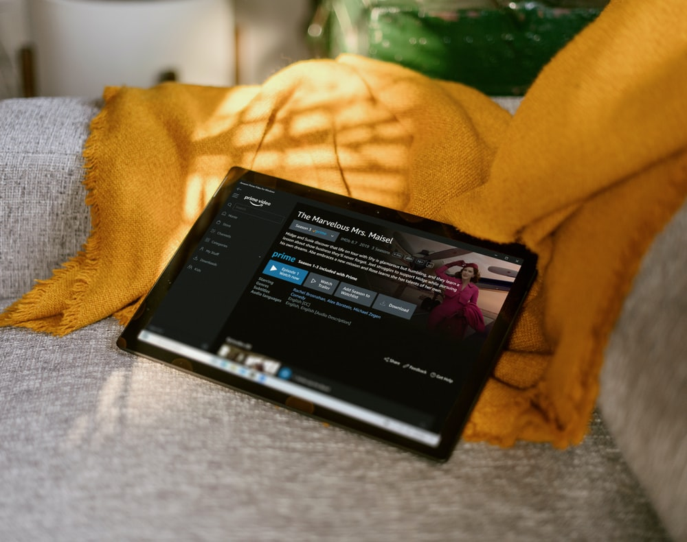 black tablet Surface device on couch