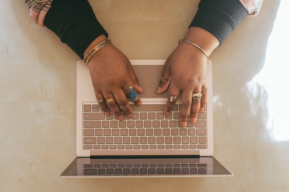 person wearing silver ring using a Surface device