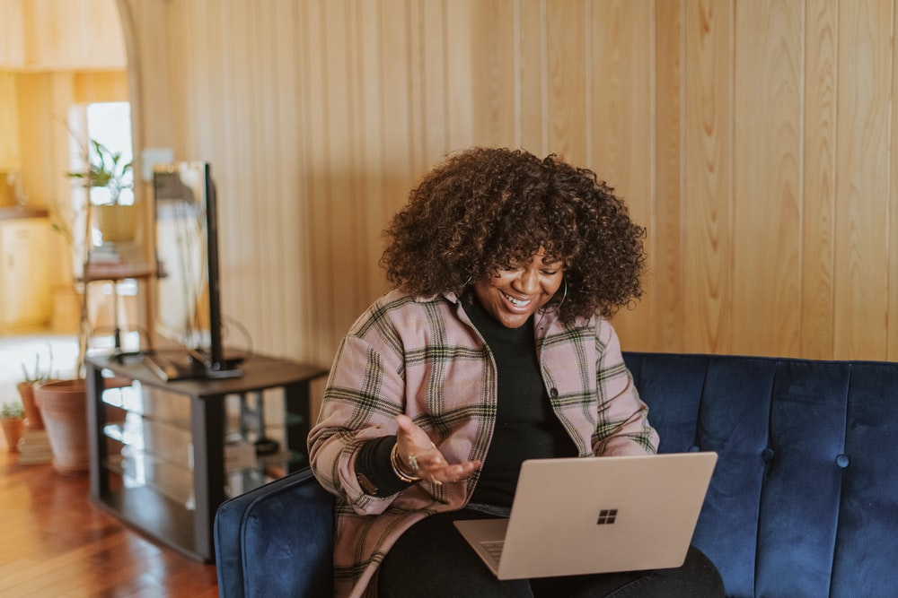person sitting on couch holding a Surface device