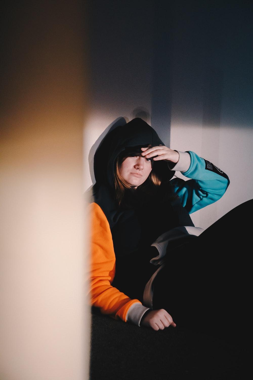 woman in black hoodie and black hat