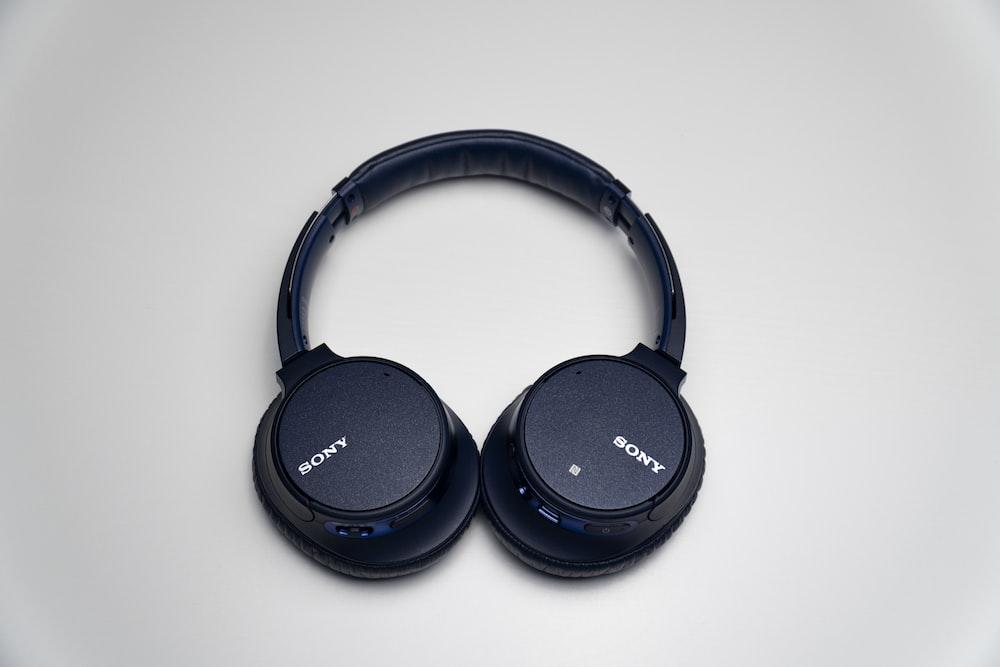 black sony headphones on white surface
