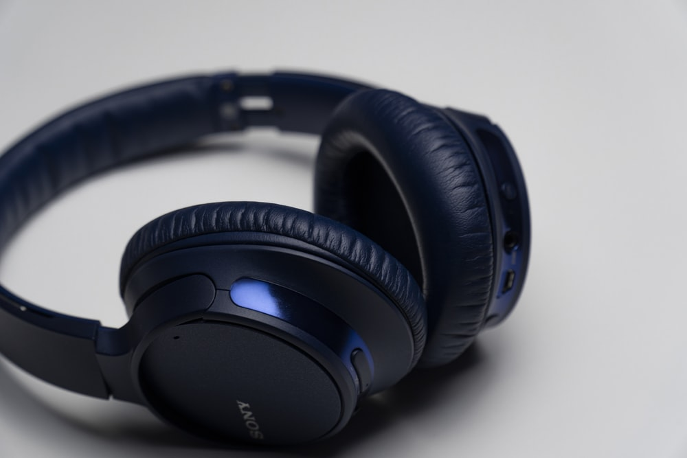 black and blue corded headphones