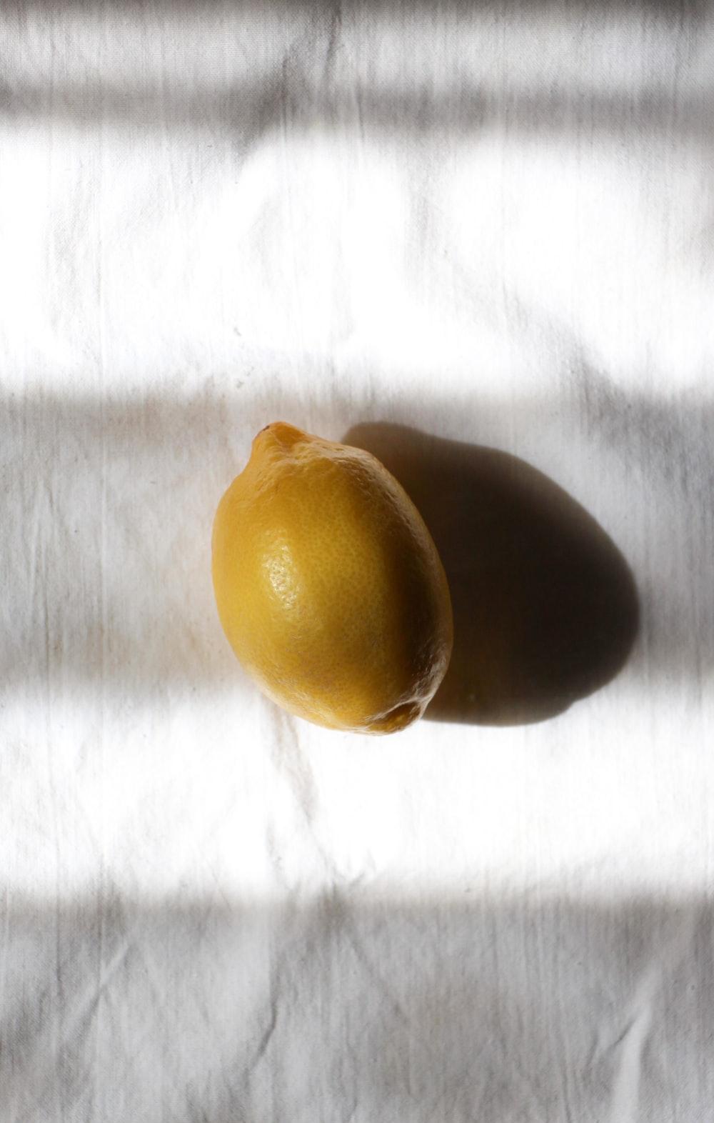 yellow fruit on white textile