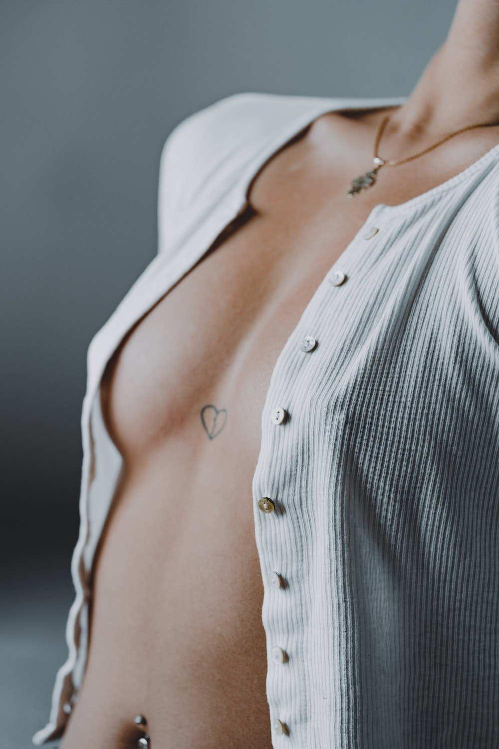 woman in white and black striped button up shirt