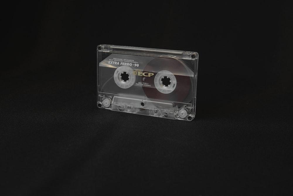 black cassette tape on black textile