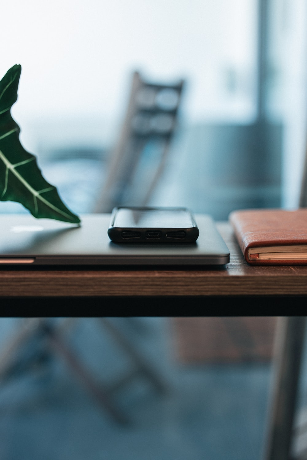 black and silver candybar phone on brown wooden table