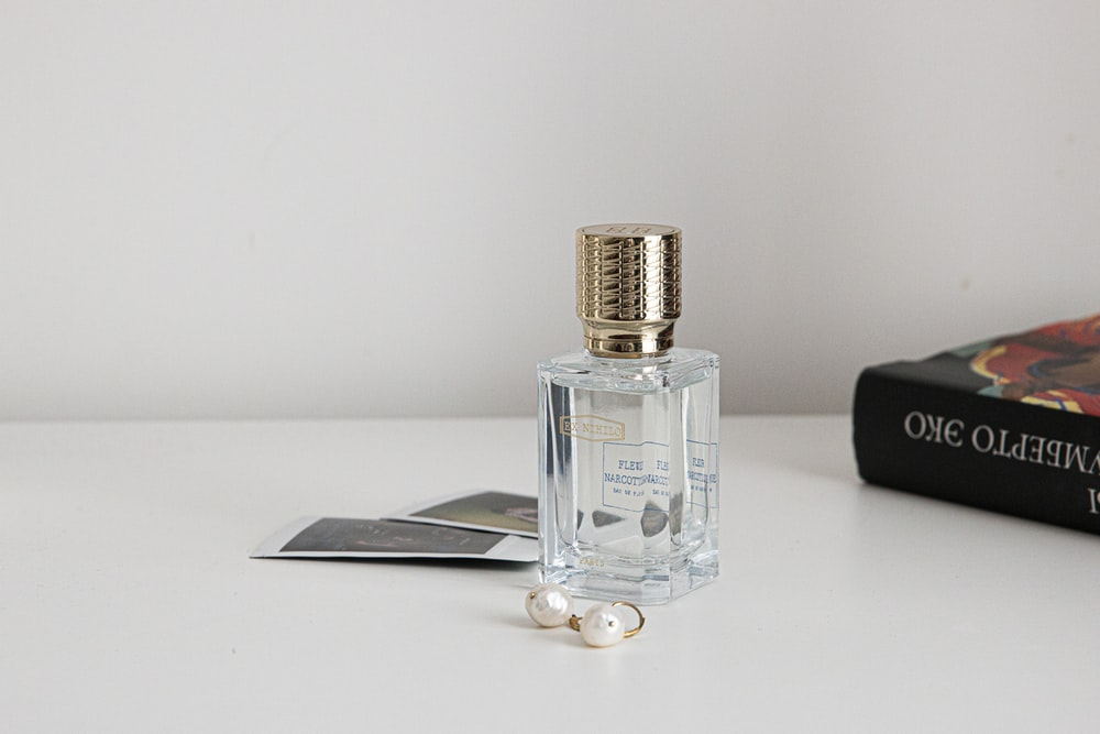 clear glass bottle with silver lid
