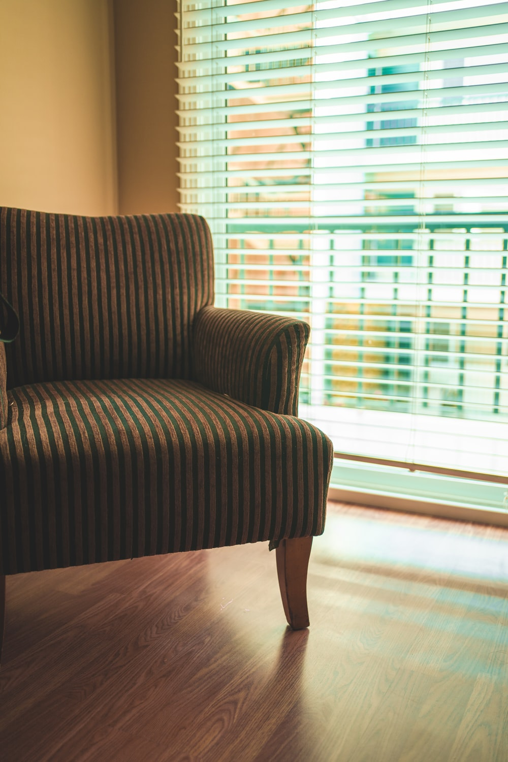 brown and black striped sofa chair