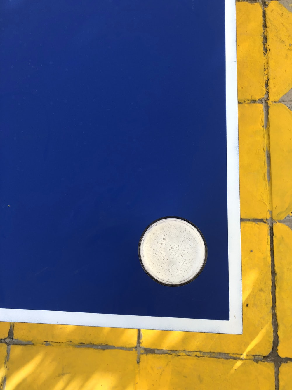 blue and white board with hole