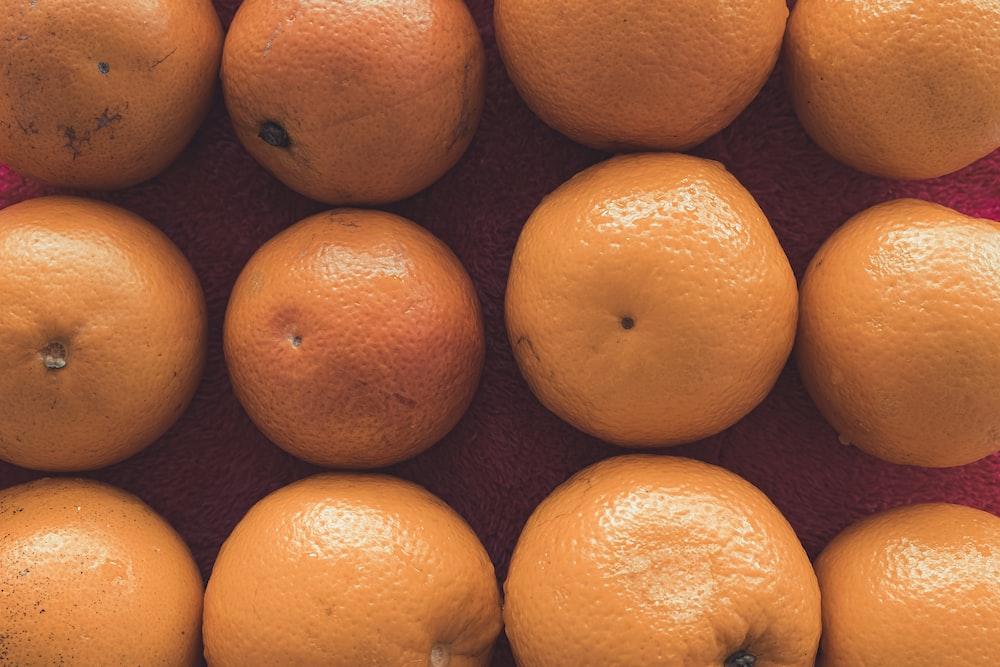 orange fruits on brown surface