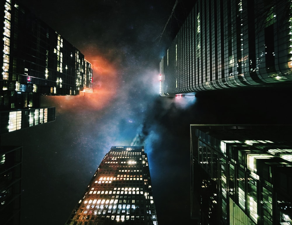 high rise building with lights turned on during night time