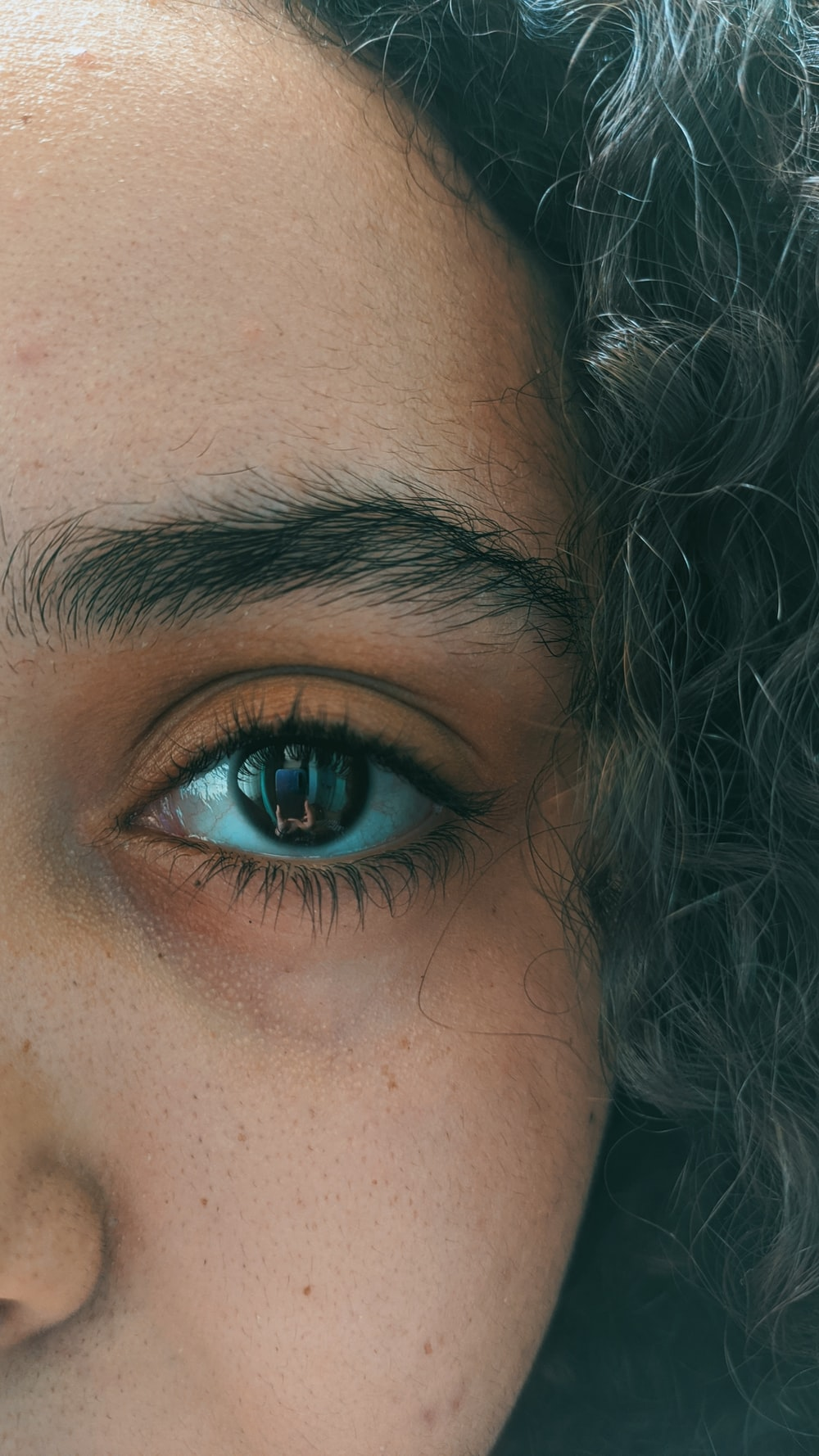 woman with black hair and blue eyes