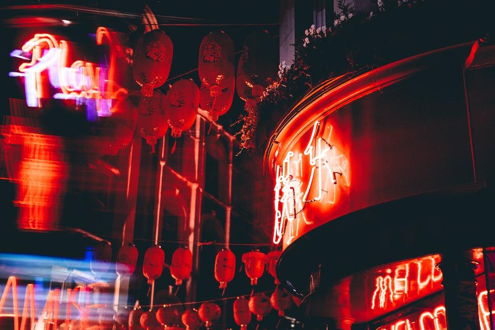 red chinese lanterns on street during night time