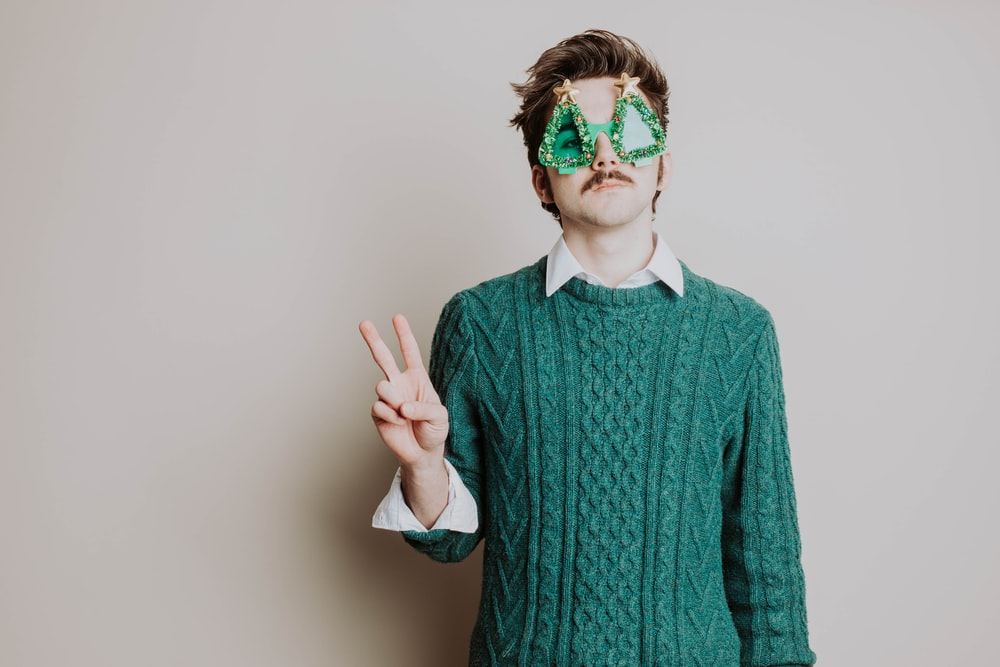 man in green sweater wearing green sunglasses