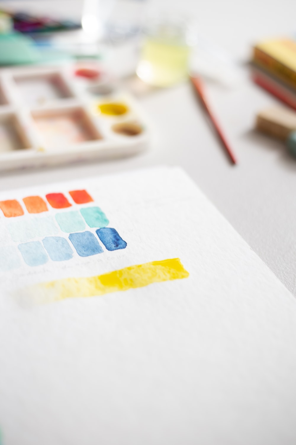 white yellow and red printer paper