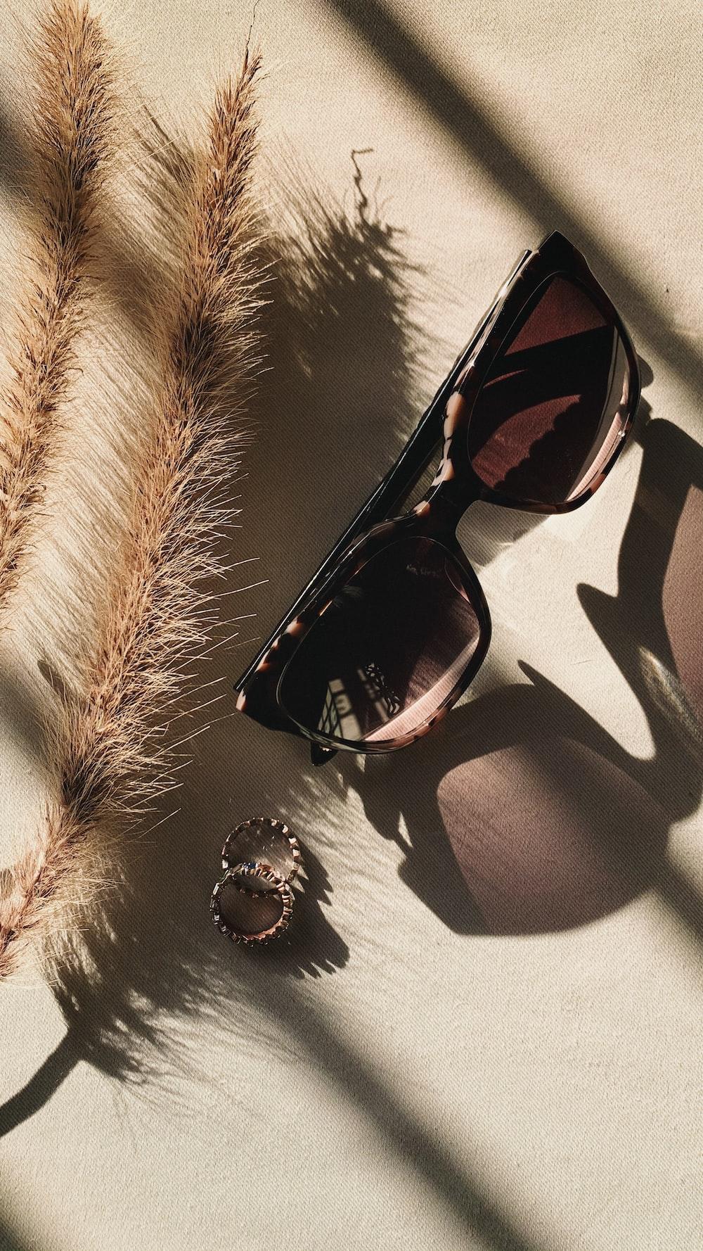 black framed sunglasses on white and black textile