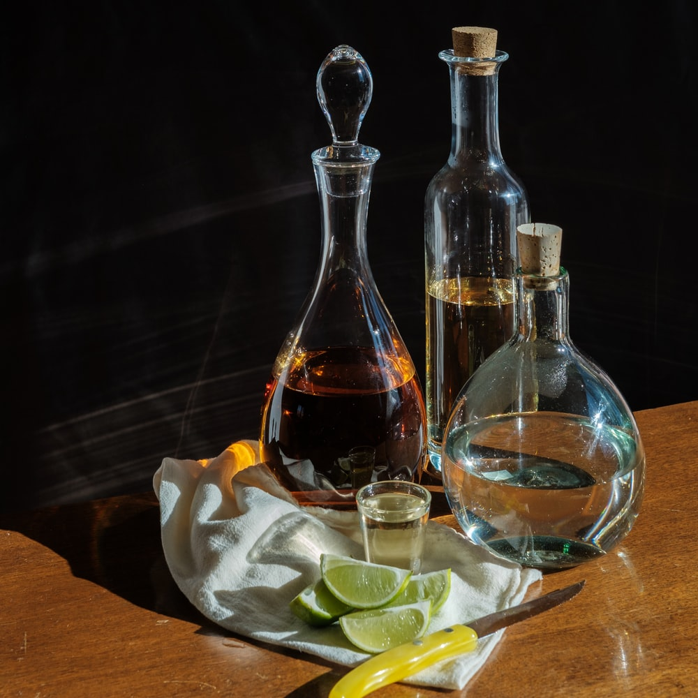 clear glass bottles on brown wooden table