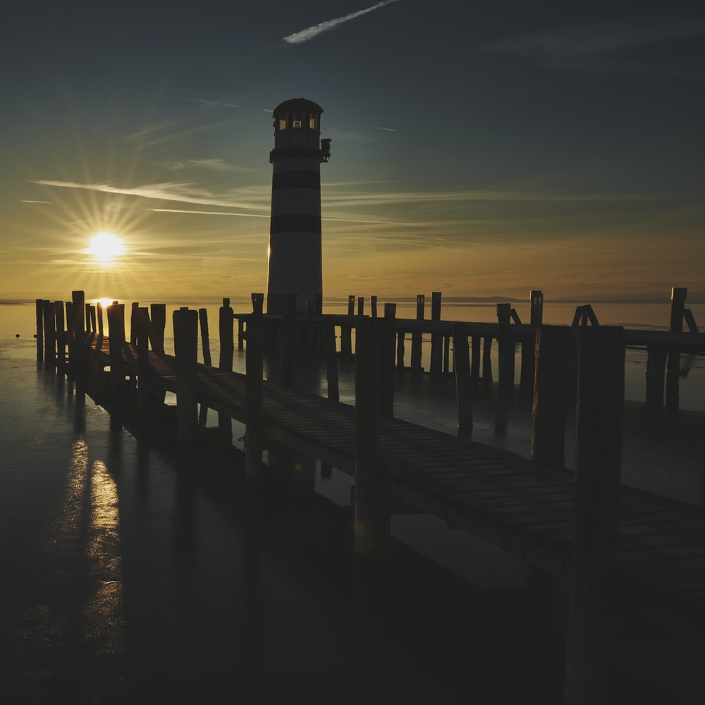 silhouette of dock during sunset
