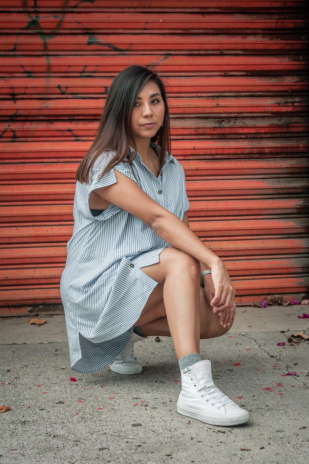 woman in white dress sitting on concrete floor