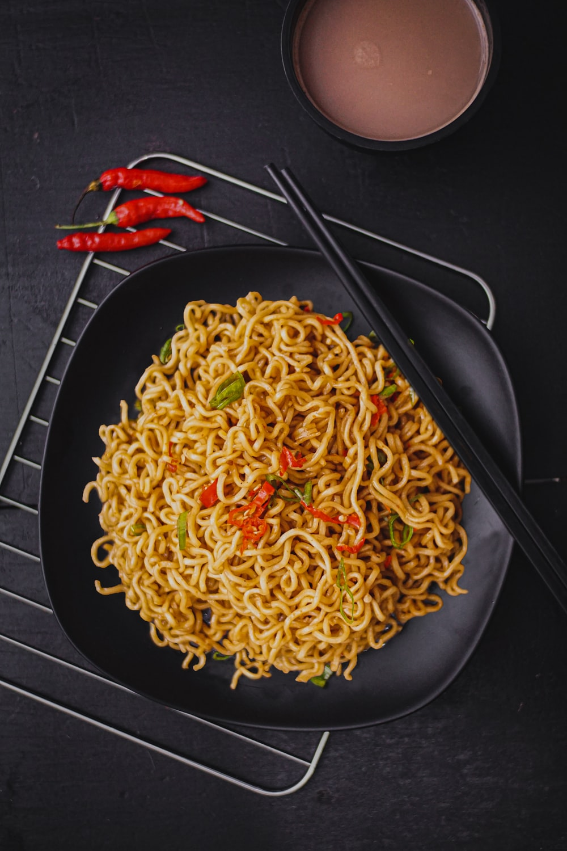 pasta dish on black plate