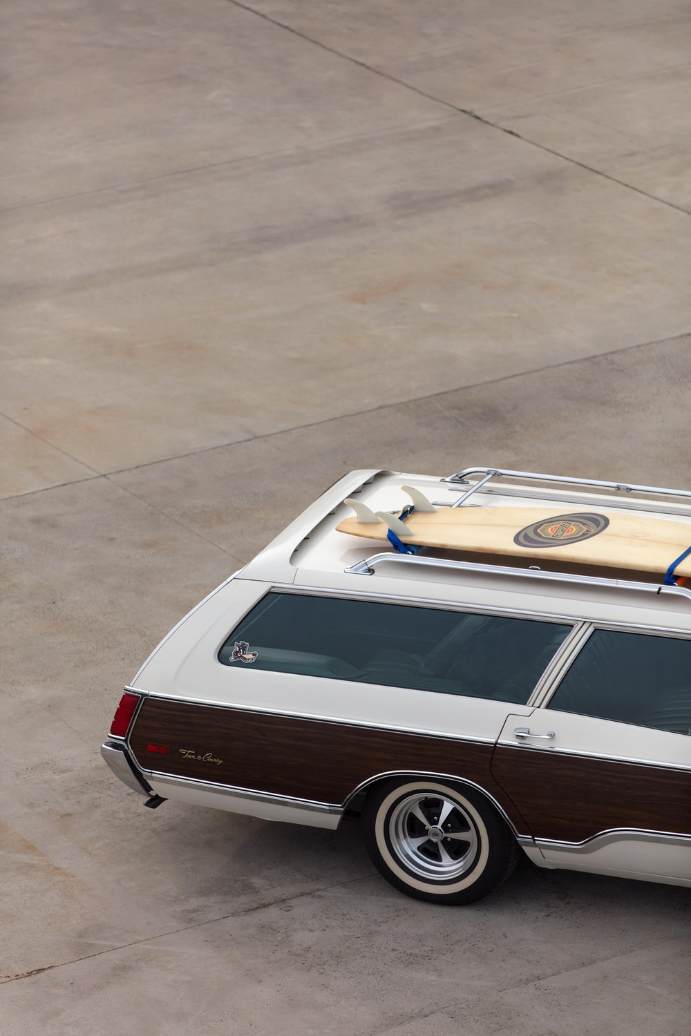white and brown station wagon