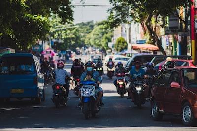 Kota Bharu people riding motorcycle on road during daytime