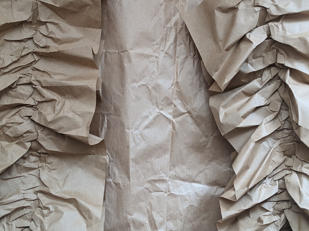 brown paper on white textile