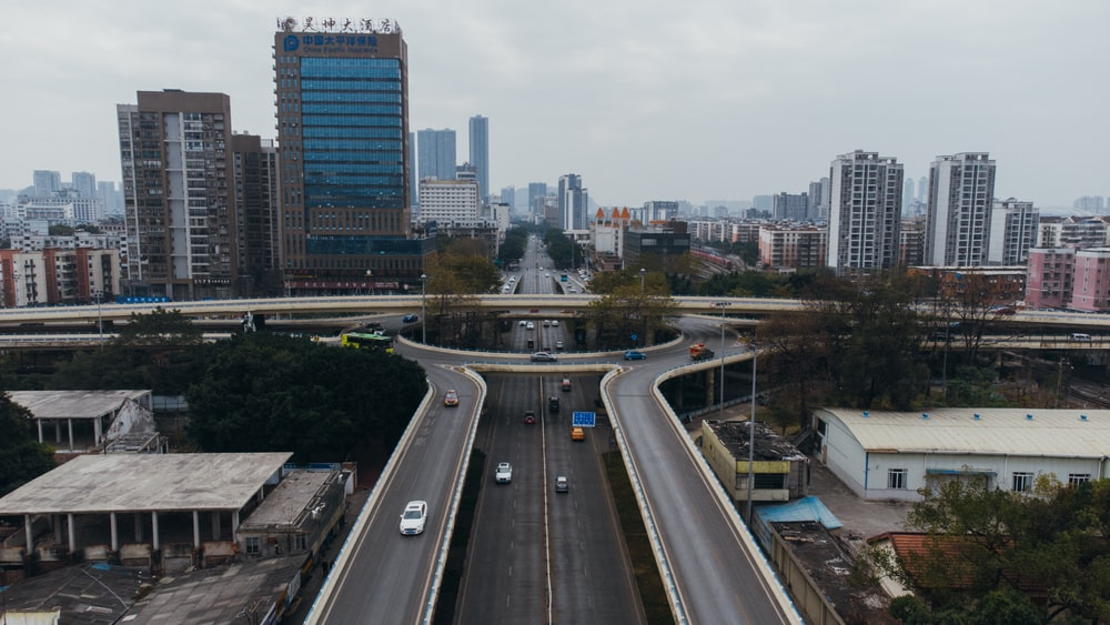 city buildings and road during daytime