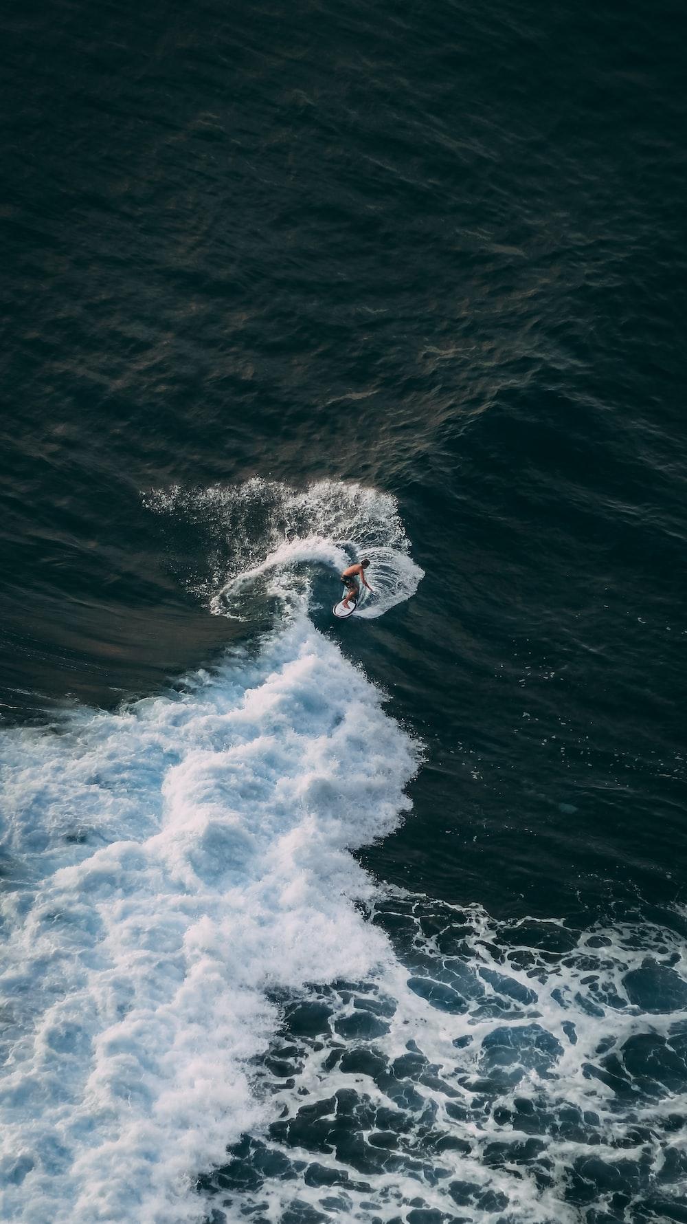 white sea waves during daytime