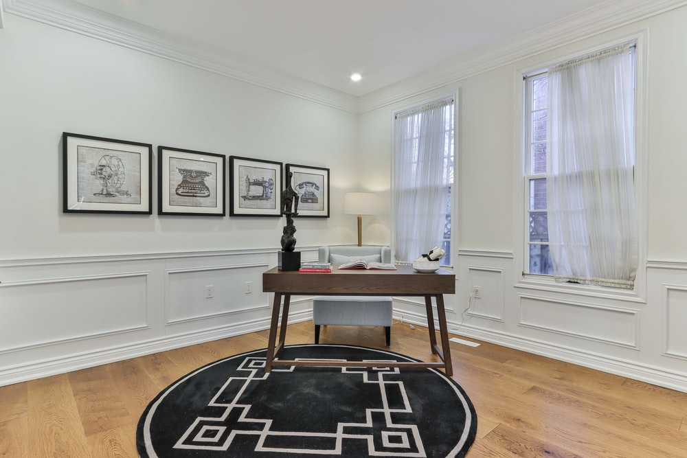 black and white round area rug on brown wooden parquet floor