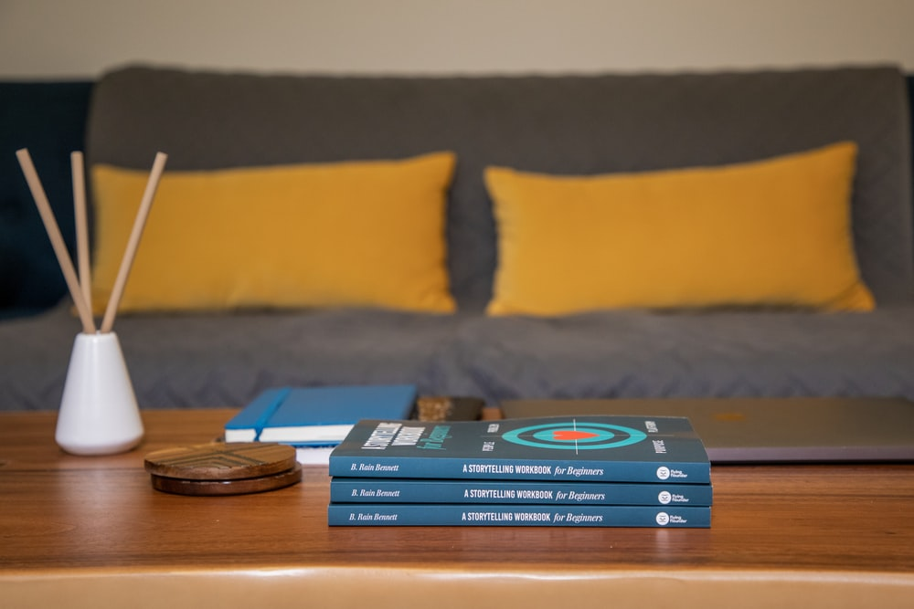 blue and yellow book on brown wooden table