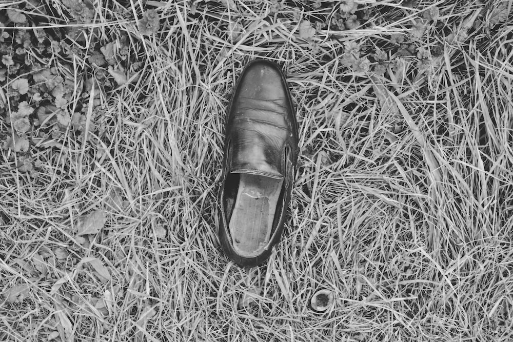 black leather shoe on grass