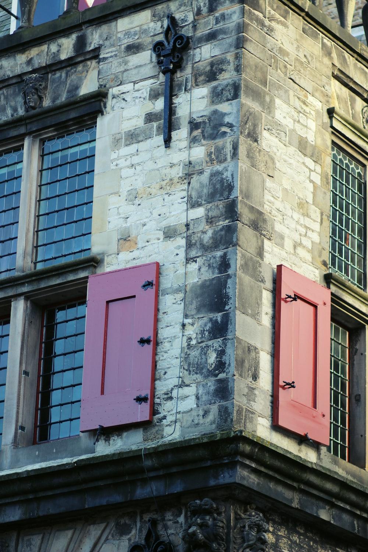 red wooden door on gray concrete building