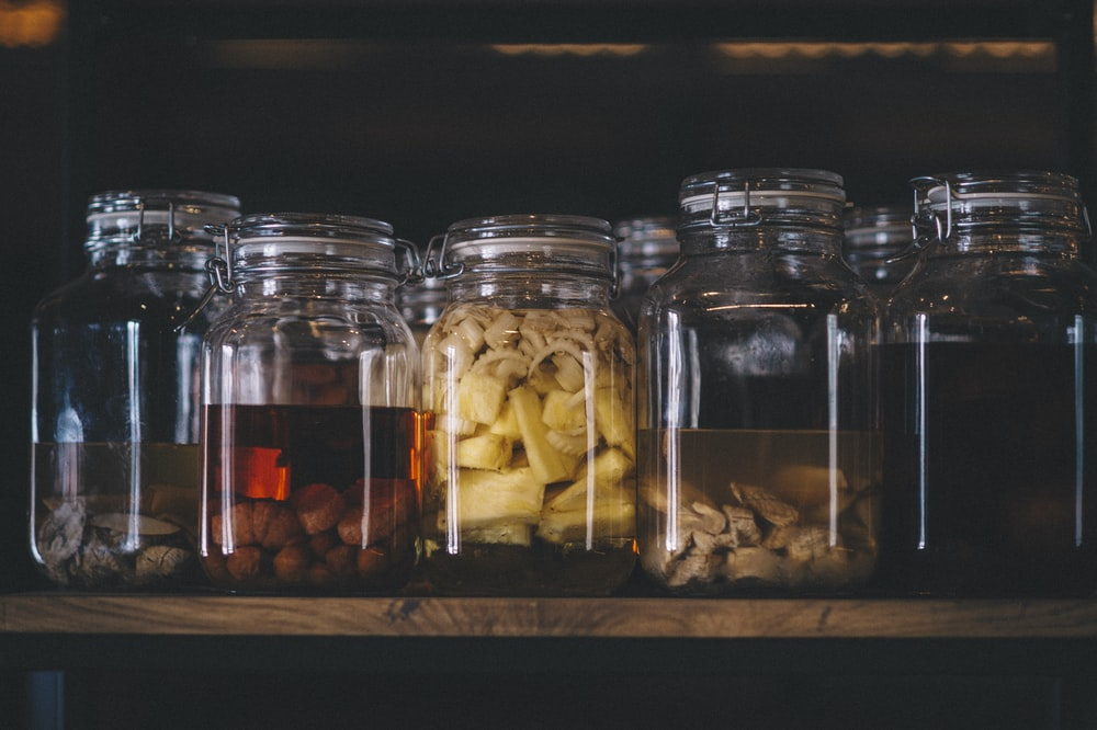clear glass jars with brown and white stones