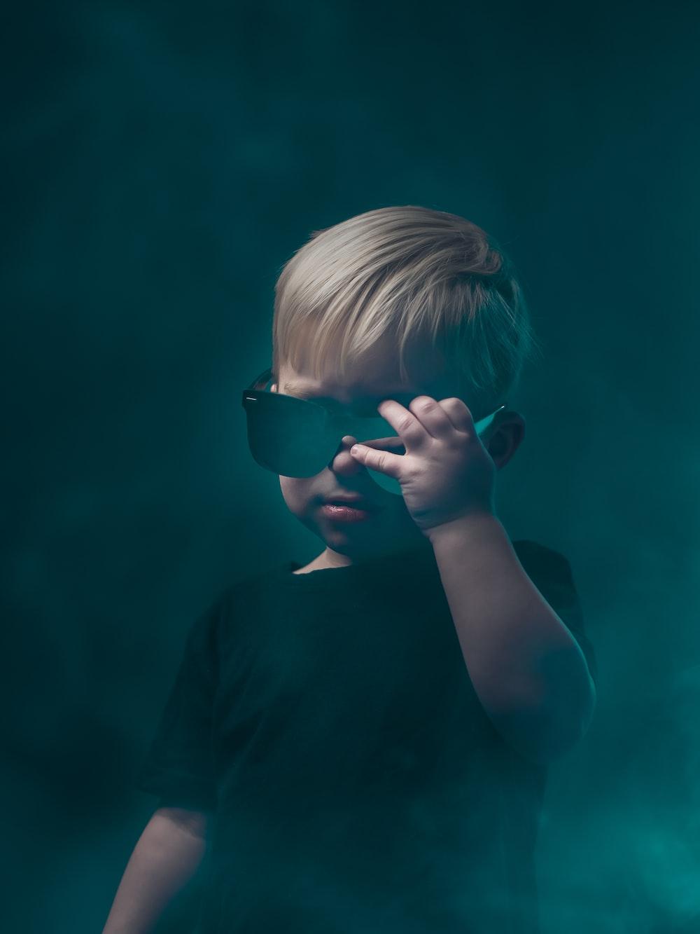 girl in black shirt wearing black sunglasses