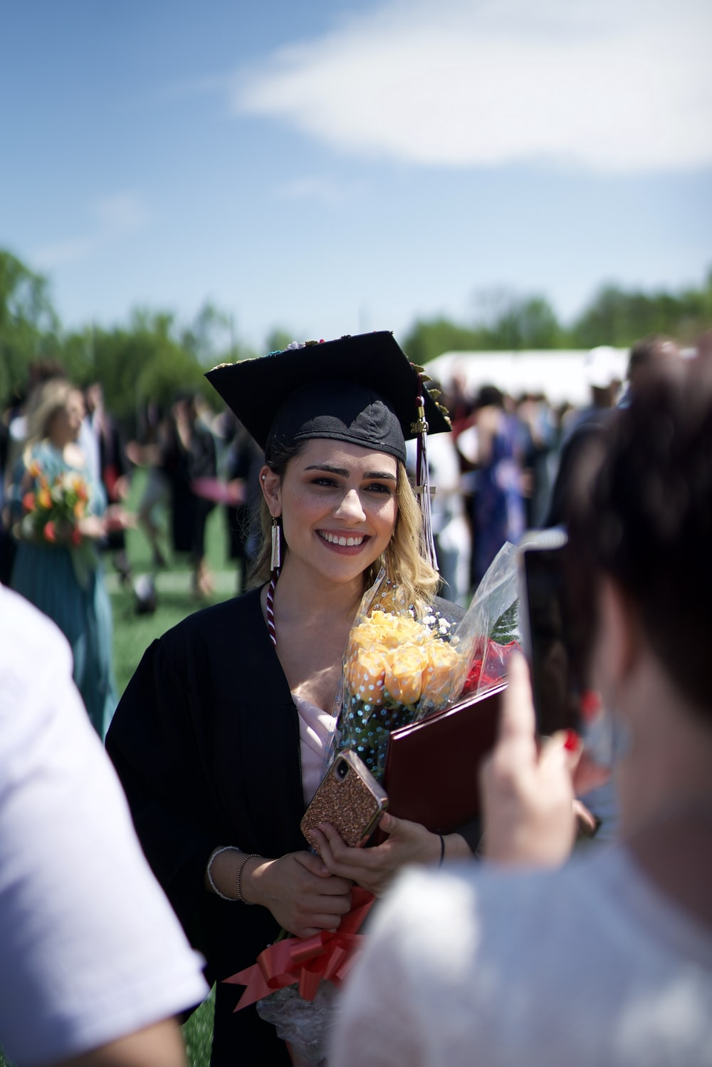 woman in academic dress smiling