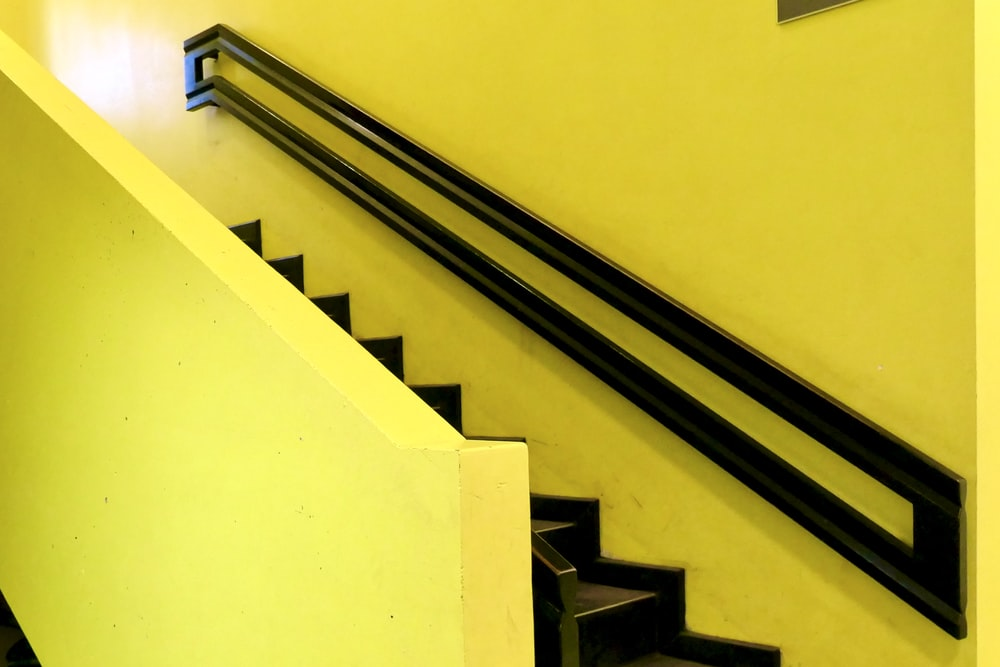 yellow and black concrete staircase