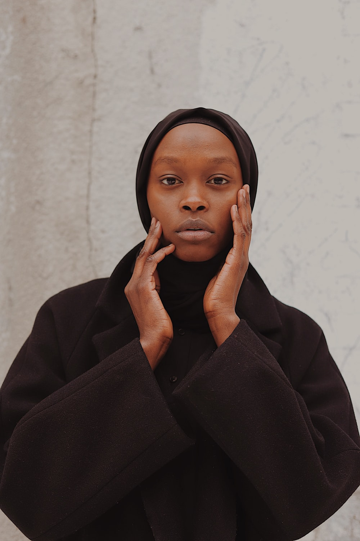 woman in black coat and black hijab