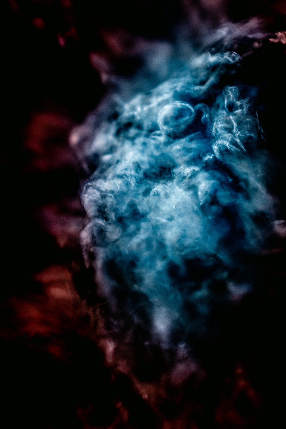 white and blue smoke in close up photography