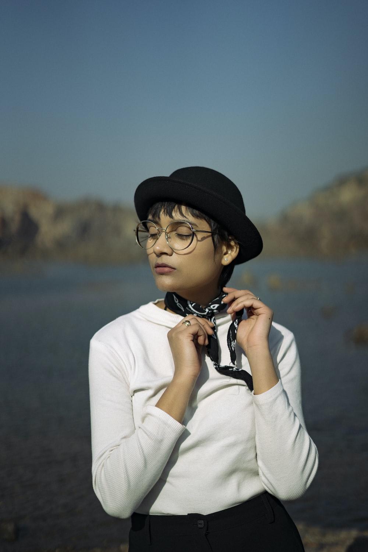 boy in white shirt wearing black hat