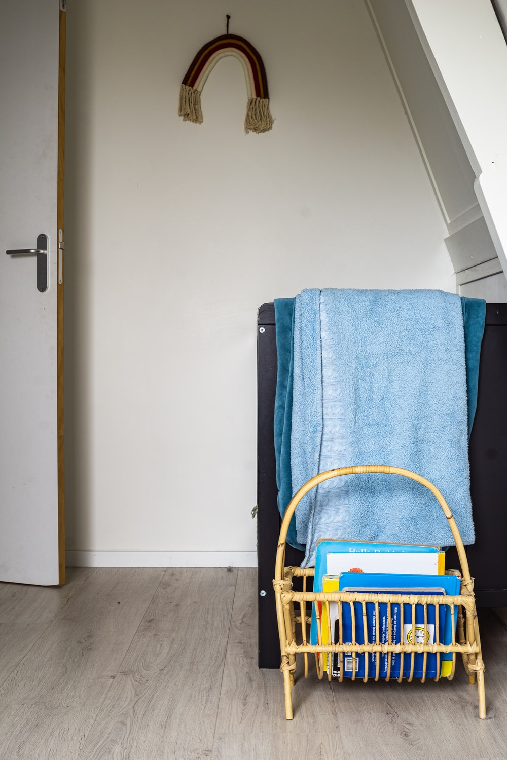 blue towel on brown wooden chair
